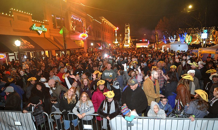 Large crowds party during the 7th annual New Year's eve Whiskey Row Boot Drop in Prescott Sunday night. The 6-foot tall boot dropped twice, once at 10 p.m. when New York celebrated the new year and again at midnight.