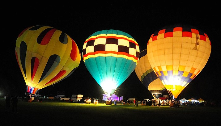 With four balloons inflated the party continues at the inaugural Arizona Craft Distillers Guild Festival and Balloon Glow Friday, June 9 on the football field at Prescott Mile High Middle School. (Les Stukenberg/Courier)
