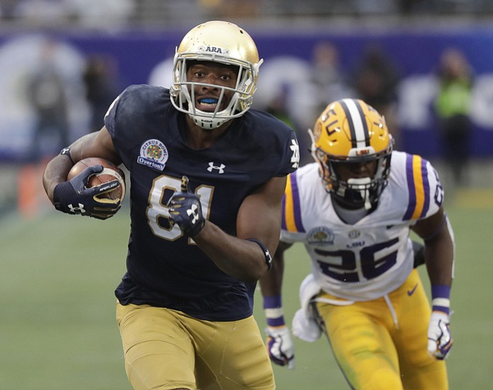 Notre Dame wide receiver Miles Boykin, left, runs to the end zone past LSU safety John Battle (26) on his way to the score the game-winning touchdown during the second half of the Citrus Bowl on Monday, Jan. 1, 2018, in Orlando, Fla. Notre Dame won 21-17. (John Raoux/AP)