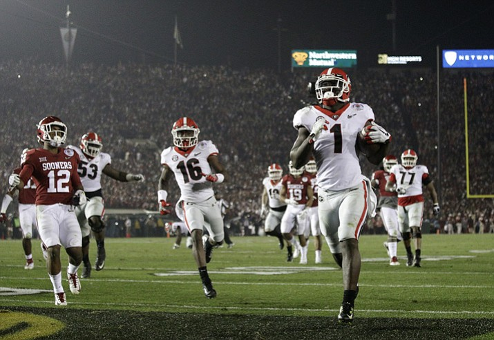 Georgia running back Sony Michel (1) scores a touchdown in overtime against Oklahoma in the Rose Bowl on Monday, Jan. 1, 2018, in Pasadena, Calif. Georgia won 54-48. (Jae C. Hong/AP)