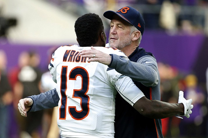 Chicago Bears head coach John Fox hugs wide receiver Kendall Wright (13) before an NFL football game against the Minnesota Vikings, Sunday, Dec. 31, 2017, in Minneapolis. (Bruce KluckhohnAP)
