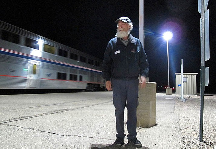 In this Friday, Dec. 29, 2017 photo, Len Daley waits for the last passengers from an Amtrak train at Williams Junction to board shuttles to nearby Williams, Ariz. Service at the Williams Junction station ended Monday, Jan. 1, 2018. Passengers now are dropped off and picked up in downtown Flagstaff. (Felicia Fonseca/AP)