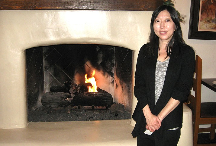 Jonda Evans, general manager, graciously posed at the hearth of Quality Kitchen and Bar. Her husband , Michael Clancy, is the executive Chef.