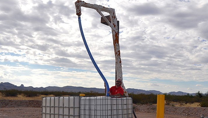 Golden Valley resident Michael Basile prepares to fill three water cubes on his trailer at GVID Standpipe 1 at Bolsa Drive and Estrella Road in Golden Valley. Basile, who hauls 812 gallons of water at a time, is one of the 454 residents (both in-district and out-of-district) who use the standpipe operation to fill their tanks.