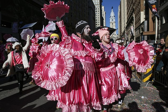 Members of the MGK Outsiders N.Y.B parade on Broad Street during the Mummers Parade in Philadelphia, Monday, Jan. 1, 2018.  (Jessica Griffin/The Philadelphia Inquirer via AP)