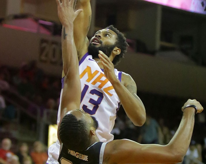 Xavier Silas (13) goes up over an Austin Spurs defender Nov. 21, 2017, in Prescott Valley. Silas scored 25 point in a 113-108 win over the Rio Grande Valley Vipers on Tuesday, Jan. 2, 2018, in Hidalgo, Texas. (Matt Hinshaw/NAZ Suns, File)