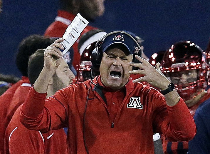 In this Nov. 25, 2016, file photo, Arizona coach Rich Rodriguez reacts after a penalty during the second half of the teams game against Arizona State in Tucson. Rodriguez was fired Tuesday, Jan. 2, 2018, by Arizona. (Rick Scuteri/AP, File)
