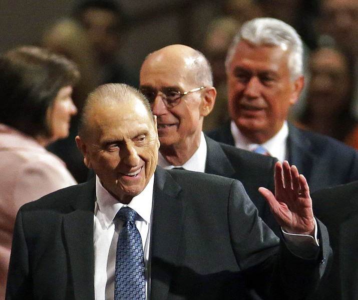 President Thomas S. Monson, of The Church of Jesus Christ of Latter-day Saints, waves to the audience during the opening session of the Mormon church conference in Salt Lake City. Monson, the 16th president of the Mormon church, died after nine years in office. He was 90. (2015 AP Photo/Rick Bowmer, File)