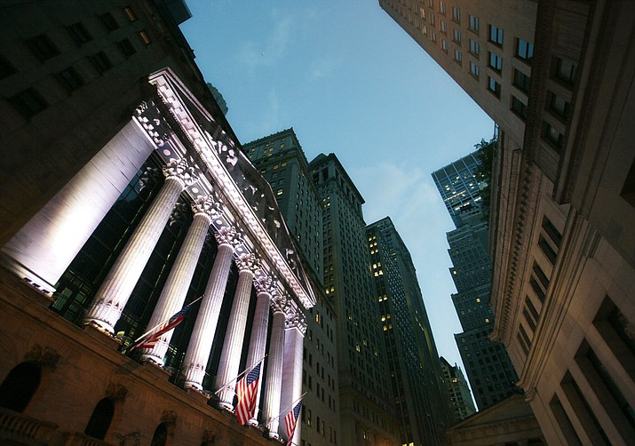 FILE - In this Oct. 8, 2014, file photo, American flags fly in front of the New York Stock Exchange. Technology companies are again leading U.S. stocks higher early Wednesday, Jan. 3, 2018, as indexes continue to trade at all-time highs (AP Photo/Mark Lennihan, File)