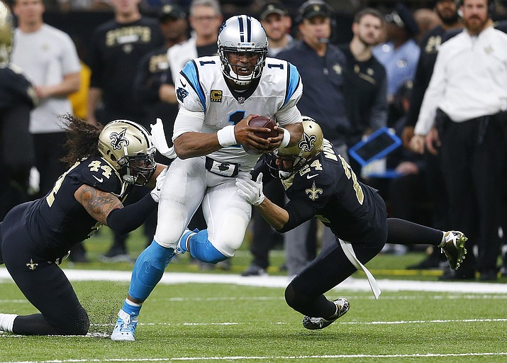 In this  Sunday, Dec. 3, 2017 file photo, Carolina Panthers quarterback Cam Newton (1) tries to avoid the tackle in New Orleans. (Butch Dill/AP, File)