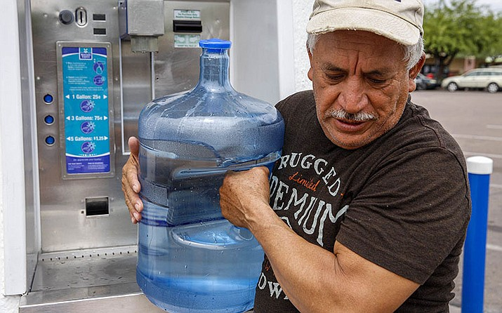 Francisco Tavira, 62, earns $12 an hour at Sierra Sun Landscaping in Tempe and spends about $20 a month to refill his water bottles.