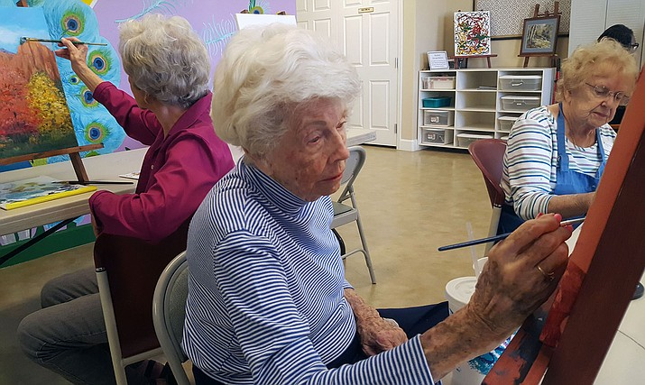 Theresa Turpin, 86, right, a La Loma resident, said the best part about the program is getting to be there with great friends and letting worries go. (Photo by Alyssa Williams/Cronkite News)