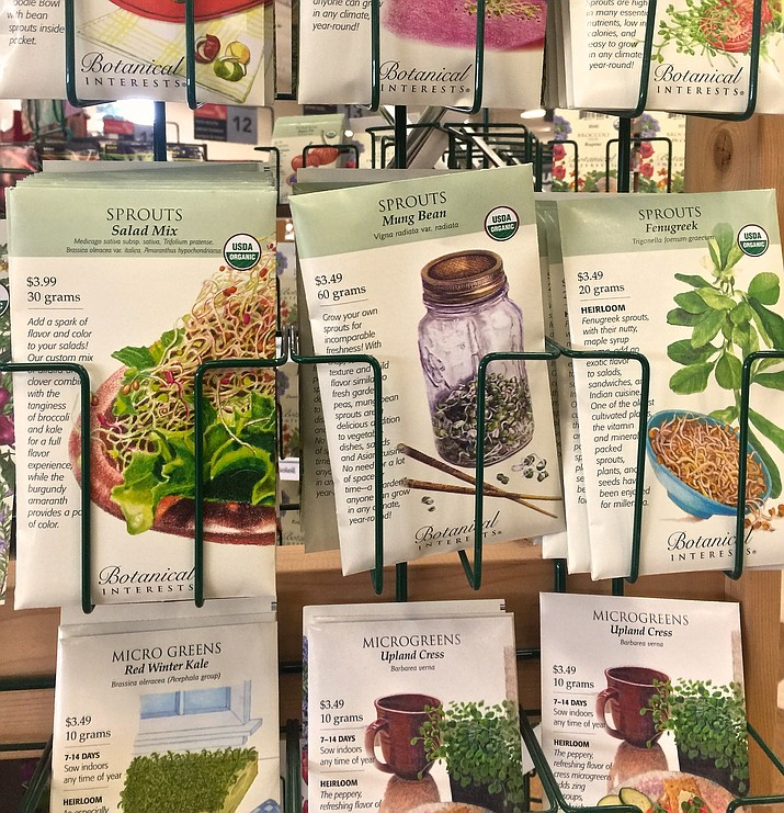 This Nov. 17, 2017 photo shows seed packets at a store in Freeland, Wash. The packs are great little reference tools. (Dean Fosdick via AP)