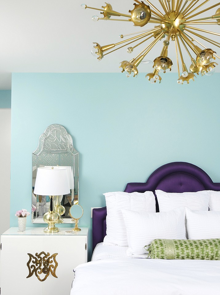 This undated photo provided by Jessica McClendon/Glamour Nest shows a bedroom designed by McClendon. Pantone's Color of 2018, Ultra Violet, can bring a touch of luxury to home decorating, especially when used sparingly in rich upholstery fabrics as seen in this bedroom designed by McClendon, founder of the Los Angeles-based design firm Glamour Nest. (Scott Rickels/Jessica McClendon/Glamour Nest via AP)