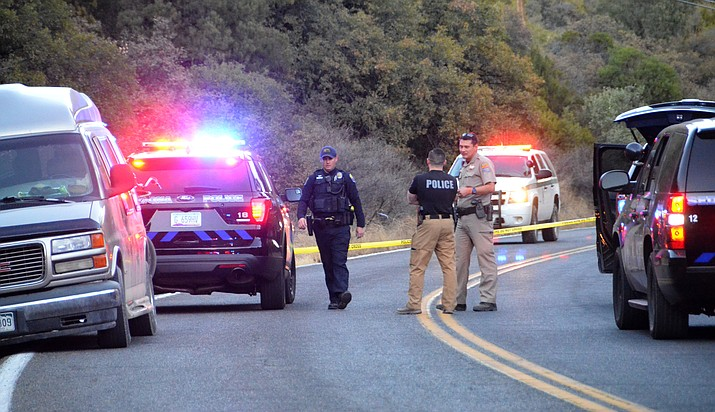 Law enforcement officers block Highway 89A in Oak Creek Canyon on Friday afternoon, after an officer-involved shooting.