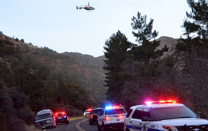 A helicopter enters Oak Creek Canyon in response to an officer-involved shooting Friday.