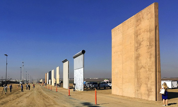 This Oct. 26, 2017 file photo shows prototypes of border walls in San Diego. The Trump administration has proposed spending $18 billion over 10 years to significantly extend the border wall with Mexico. The plan provides one of the most detailed blueprints of how the president hopes to carry out a signature campaign pledge. (AP Photo/Elliott Spagat, File)