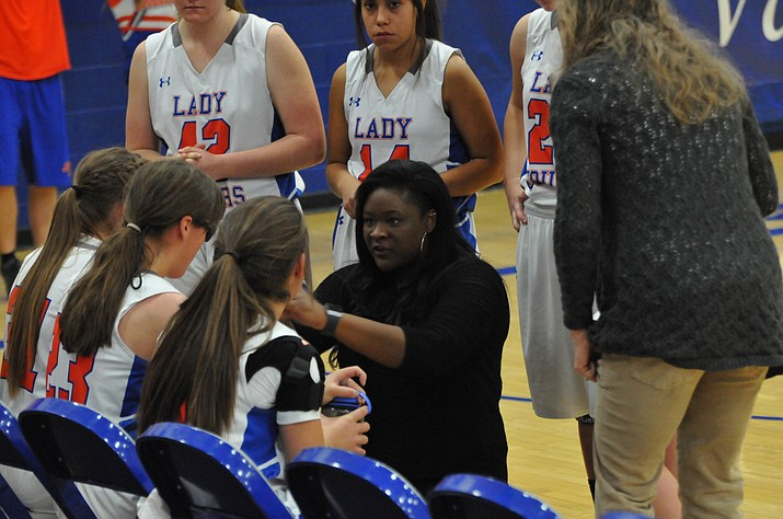 Chino Valley girls' basketball head coach Charise Hall talks with her team during a timeout against Sedona on Friday, Jan. 5, 2018, in Chino Valley. (Doug Cook/Courier)