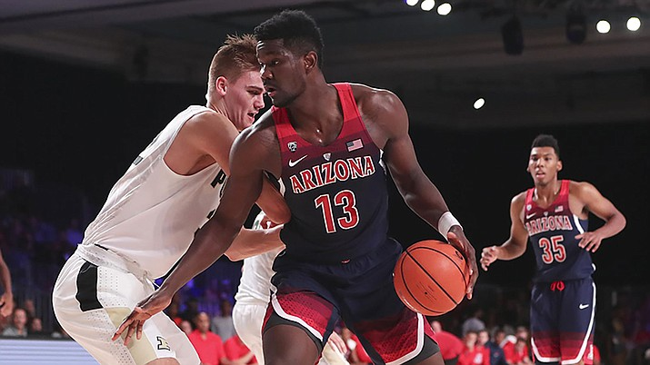 Deandre Ayton scored 24 points and grabbed 14 rebounds in Arizona's 94-82 win over Utah Thursday night.