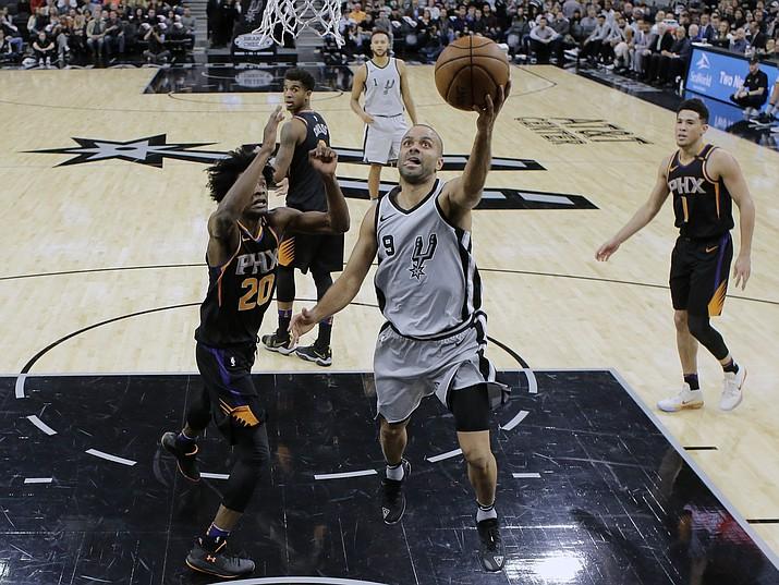 San Antonio Spurs guard Tony Parker (9) drives past Phoenix Suns forward Josh Jackson (20) during the first half Friday, Jan. 5, 2018, in San Antonio. (Eric Gay/AP)