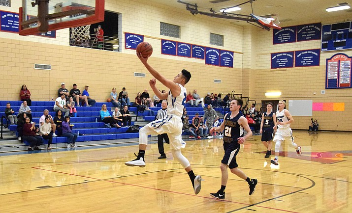 Camp Verde sophomore Abe Gonzalez scores after getting a steal during the Cowboys' 65-59 loss to Glendale Prep on Friday. Gonzalez had 21 points and 3 steals. (VVN/James Kelley)