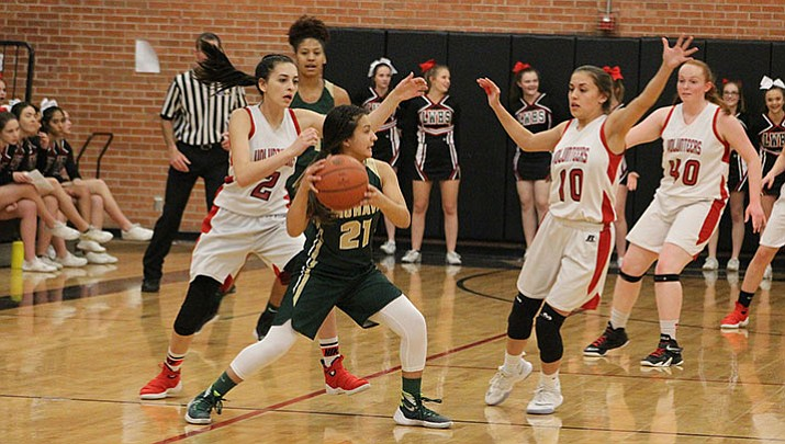 From left, Lee Williams' Hayle Davis (2) and Madison Arave (10) defend Mohave's Madiana Duarte (21) Friday night in the Lady Vols' 25-21 win.