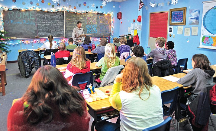 Jeffrey Holmes teaches his sixth-grade class a history lesson in this 2014 image taken at the Mountain Oak School in Prescott. (Courier, file photo)