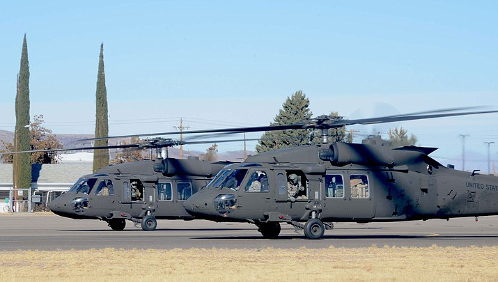 "A pair of U.S. Army UH-60M Black Hawk ""Mike"" helicopters are parked on the tarmac Friday at Kingman Airport."