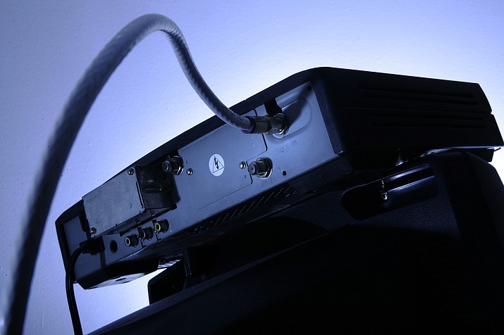 This 2007, file photo shows a cable box on top of a television in Philadelphia. (AP Photo/Matt Rourke, File)