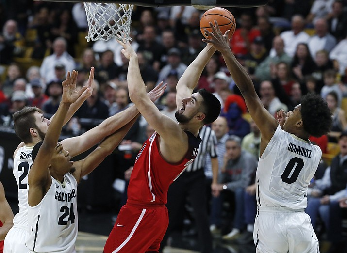 Arizona center Dusan Ristic, third from left, goes up for a basket as, from left, Colorado forward Lucas Siewert and guards George King and D'Shawn Schwartz defend in the first half of an NCAA college basketball game, Saturday, Jan. 6, 2018, in Boulder, Colo. (David Zalubowski/AP)