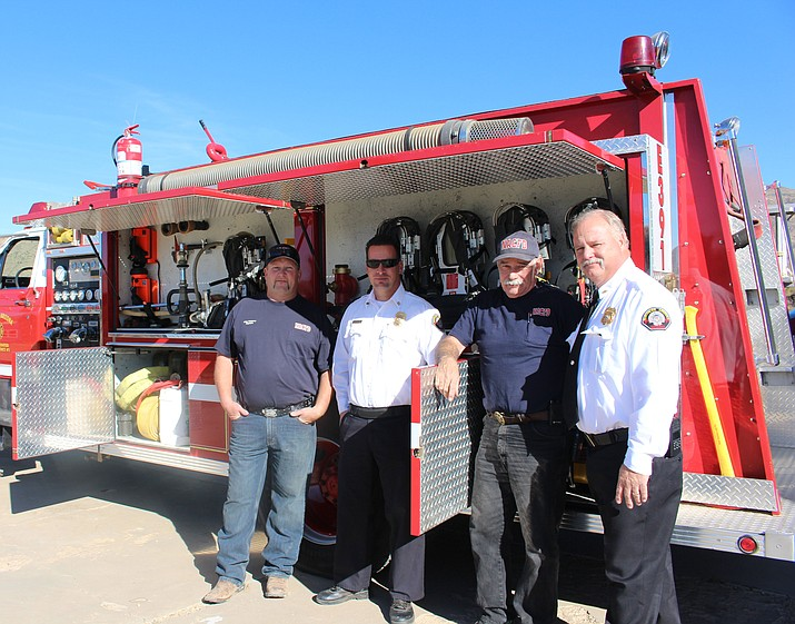Northern Arizona Consolidated Fire District is now staffing the Chloride fire station that has been closed for several years with volunteer firefighters. From left are volunteer Capt. Mike Pettway, Battalion Chief Jason Scott, volunteer firefighter Jay Fleming and Fire Chief Wayne Eder.