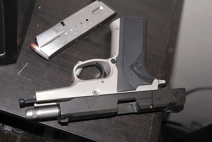 This 2014 photo shows the gun Kyle Juhl used to kill himself in Yakima, Wash. The Washington State Police had previously confiscated the gun and arranged it to be resold to the public. ( Yakima Police Department)