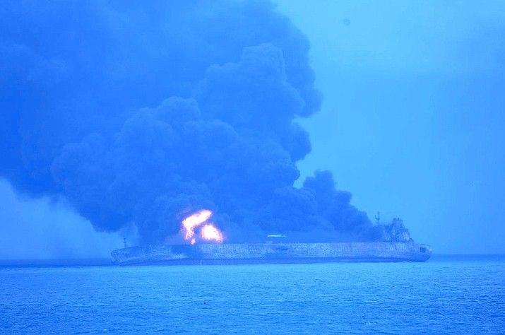"""In this photo provided by Korea Coast Guard, the Panama-registered tanker """"Sanchi"""" is seen ablaze after a collision with a Hong Kong-registered freighter off China's eastern coast Sunday, Jan. 7, 2018. The oil tanker collided with a bulk freighter and caught fire off China's eastern coast, leaving its entire crew of 32 missing, most of them Iranians, authorities said. (Korea Coast Guard via AP)"""