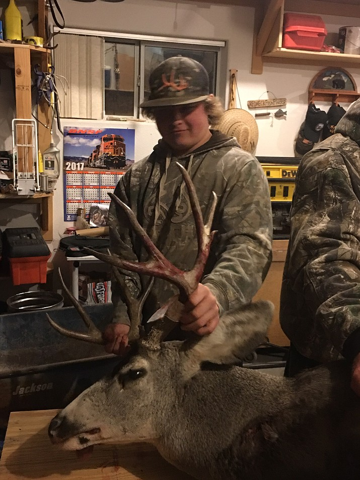 Kingman resident Adam Chastain shows the 5x4 buck he bagged on a juniors' muzzleloader hunt in Unit 16A, the Hualapai Mountains.