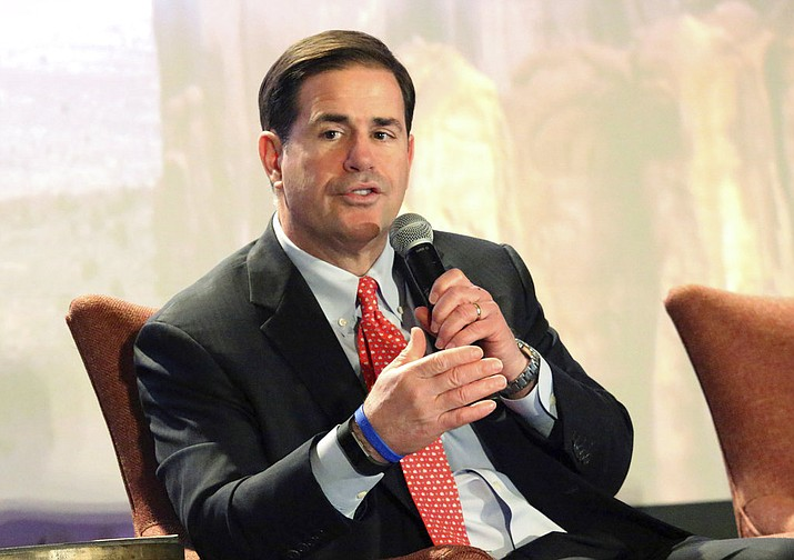 Arizona Gov. Doug Ducey addresses business leaders and lawmakers at the Arizona Chamber of Commerce's annual legislative forecast luncheon in Phoenix, Friday, Jan. 5, 2018. Gov. Ducey will deliver his fourth state of the state address Monday, Jan. 8, 2018. (AP Photo/Bob Christie)