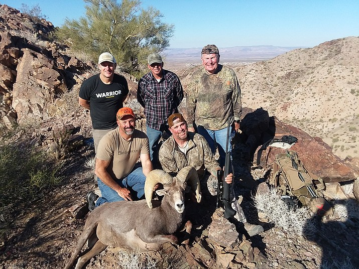 A great team of volunteers. These volunteers climbed to the top of a mountain in Unit 16A to assist in bringing disabled veteran Joe Masseur's ram off the mountain after a successful hunt. Back row left to right: Brian Williams, Brad Shelton, Steve Tague. Front row, left to right: Mike Hulsey and Joe Masseur.