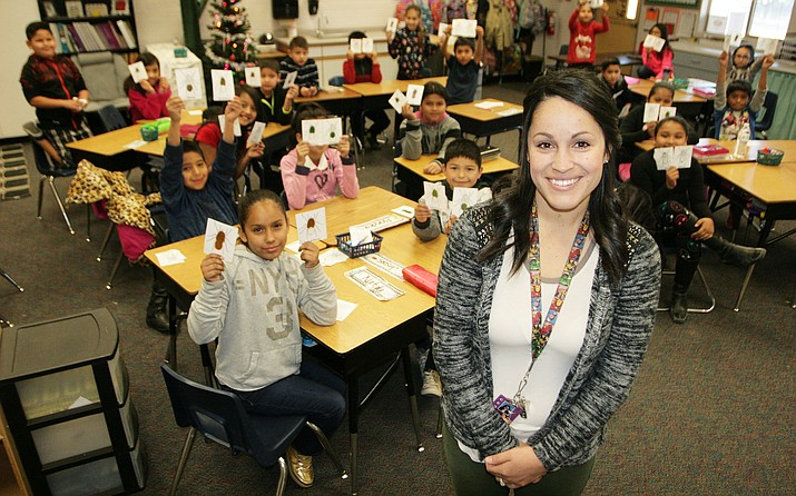 """The most rewarding thing to me is getting through to a struggling student,"" says Maranda Moran, third grade teacher at Cottonwood Elementary School. ""I don't mean when they finally get an A on their report card, but when they are able to confide in me about something or when they reach out to me for help. That is the true reward with these kiddos."" (Photo by Bill Helm)"