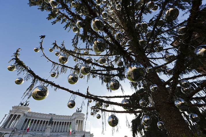 "This photo taken on Dec. 19, 2017 shows, Rome's official Christmas tree standing in front of the Unknown Soldier monument in downtown Rome. Rome's city cabinet decided on the tree's ""new life"" Tuesday, Jan. 9, 2018, hoping to close an embarrassing chapter that saw the tree, so droopy and dried out it was nicknamed ""Mangy"" by Romans, come to symbolize the city's degradation and dysfunction under its 5-Star mayor, Virginia Raggi, and years of neglect and corruption before her. (AP Photo/Alessandra Tarantino)"