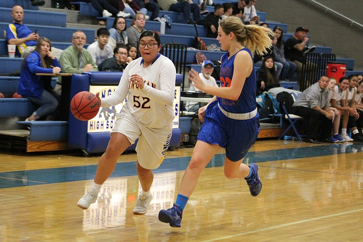 Chino Valley's Felicity Stickrod (32) tries to stay in front of Tarase Marshall (52) as the Cougars take on Kingman on Tuesday, Jan. 9, 2018, in Kingman. Chino Valley lost on the road 50-42. (Beau Bearden/KDM)