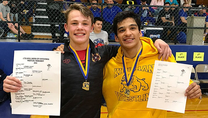 Lee Williams' Jimmy Wayman, left, and Kingman High's Ramon Chavez battled each other in the championship round of the 145-pound weight class at the Joe City Tourney over the weekend. Wayman was victorious.