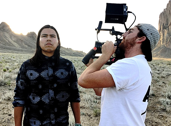"Navajo film producer Kody Dayish (left) works a photo shoot for one of his film productions. Dayish is currently producing ""Unbroken Code,"" a feature film about the Navajo Code Talkers of WWII."