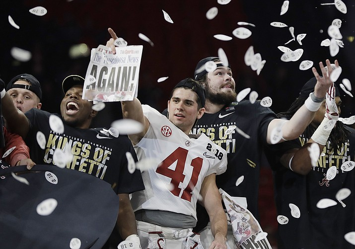 Alabama players celebrate after an overtime win in the College Football Playoff championship game against Georgia on Monday, Jan. 8, 2018, in Atlanta. Alabama won 26-23. (David J. Phillip/AP)