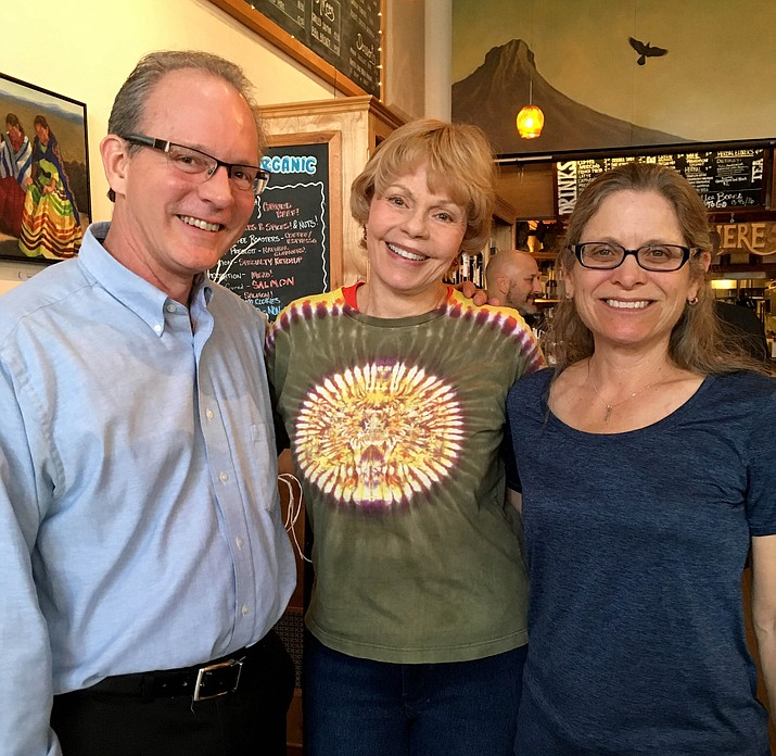 Prescott composer Henry Flurry, left, Toni Tennille, center, and Allison Dixon, orchestra administrator, meet at Raven Cafe in Prescott Jan. 5 to discuss the new Arizona Philharmonic Orchestra, an organization of professional musicians. Auditions are taking place now until March 1. (Courtesy photo)