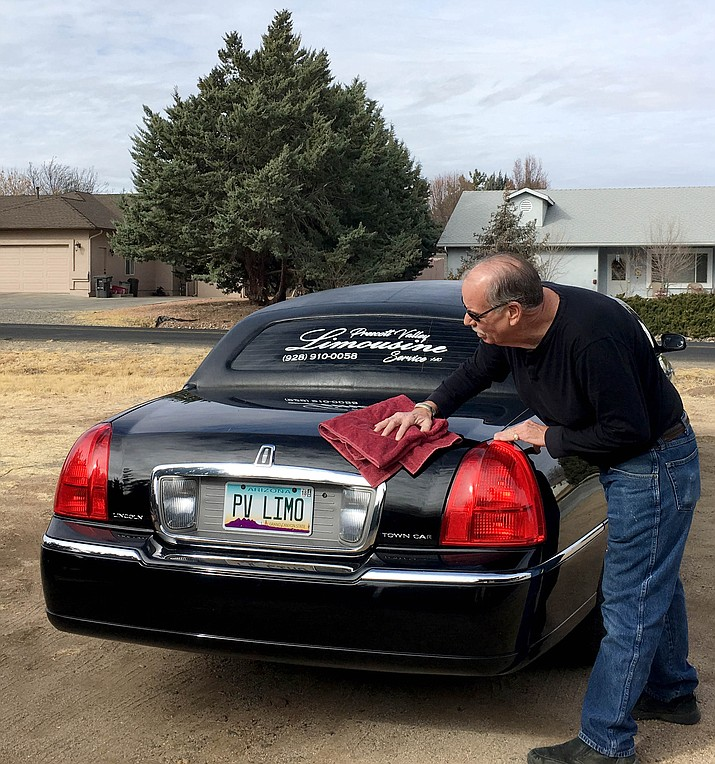 Tim Kennedy gives his 30-foot limousine a polish every week. He treats his customers like royalty and will even roll out a red carpet if requested. (Courtesy)