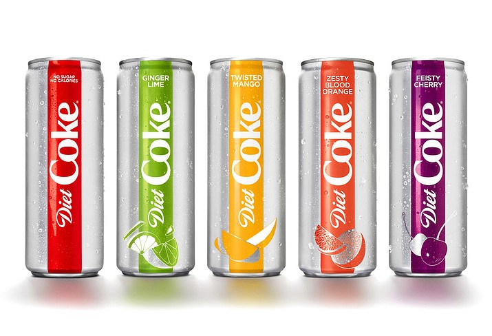 This photo provided by The Coca-Cola Co. shows examples of Diet Coke's rebranding effort. The Coca-Cola Co. says it is adding a slimmer 12-ounce Diet Coke can, refreshing the logo and offering the 35-year-old drink in four new flavors, including mango and ginger lime. The company said Diet Coke's new look and flavors were aimed to appeal to millennials. (Courtesy of The Coca-Cola Co. via AP)