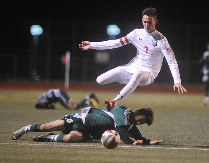 Bradshaw Mountain High School's Brandon Fischer gets fouled as the Bears take on Flagstaff High Wednesday night in a boys soccer game in Prescott Valley.