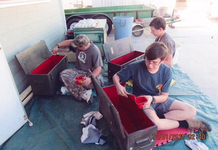 Laine Barnes, Josh Taflan and Nick Taflan of Troop 98 working on the Flag Retirement Boxes.