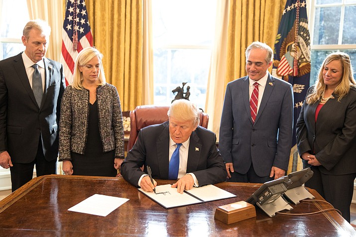 President Donald Trump signs an executive order Tuesday supporting veterans during their transition from uniformed service to civilian life.