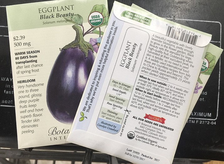 Seed packets are great little reference tools. While the front of the packets show how the seeds will look when they mature, the rear describes everything needed to grow them from spacing and soil depth to light conditions and moisture requirements. (Dean Fosdick via AP)