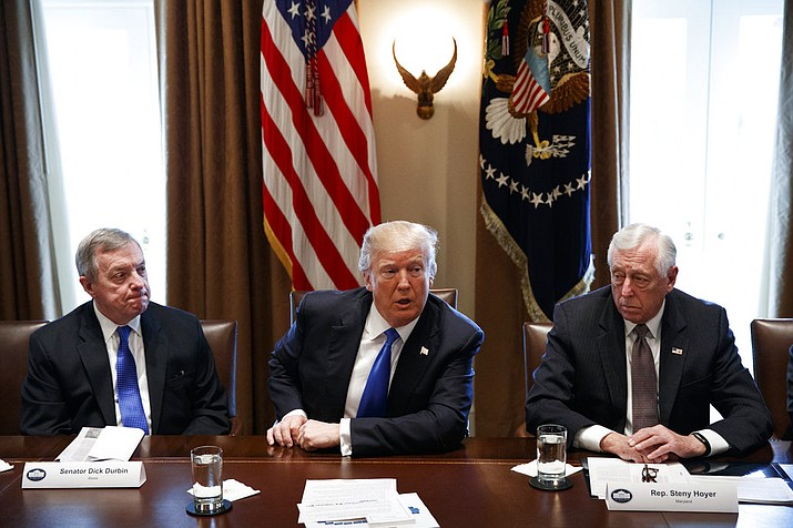 In this photo, Sen. Dick Durbin, D-Ill., left, and Rep. Steny Hoyer, D-Md. listen as President Donald Trump speaks during a meeting with lawmakers on immigration policy in the Cabinet Room of the White House in Washington. Bargainers seeking a bipartisan immigration accord planned talks as soon as Wednesday as President Donald Trump and leading lawmakers sought to parlay an extraordinary White House meeting into momentum for resolving a politically blistering issue.(AP Photo/Evan Vucci)